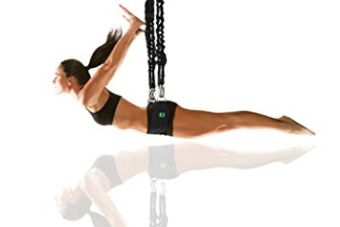 A Bungee Flight Adrenaline Rush student in black workout attire hanging from 2 bungees and a hip harness
